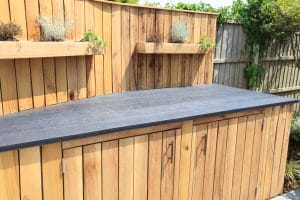 Image of outdoor kitchen area with mini herb planters