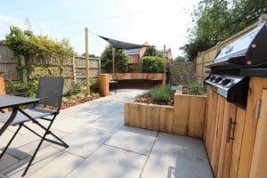 Image of Summer Entertaining Garden, bespoke curved seating area, raised planters and kitchen with BBQ